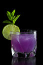 Purple cocktail closeup of a on a black background served on the rocks Stock Photo