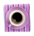 Purple coffee cup over kitchen towel view from above isolated on white background Stock Images