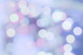 Purple colored Christmas bokeh light abstract holiday background. Royalty Free Stock Photo