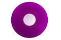 Purple colored vinyl lp record rpm with a blank label isolated on a white background Royalty Free Stock Photos