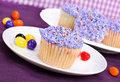 Purple Easter Cupcakes and Jelly Beans Stock Photo