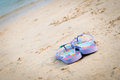 Purple flipflop on sand beach Royalty Free Stock Image