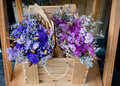 Purple Flower Bouquet and blue Flower Bouquet in a wooden bo Royalty Free Stock Photo