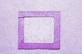 Purple frame dark of stone in a bright wall Royalty Free Stock Photography