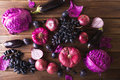 Purple fruits and vegetables. Blue onion, purple cabbage, eggplant, grapes and plums Royalty Free Stock Photo