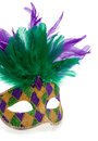 A purple gold and green mardi gras mask with feathers on a white background Royalty Free Stock Images