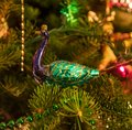 Purple and Green Peacock Christmas Tree Ornament Royalty Free Stock Photo