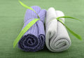 Purple and green wash cloths rolled up Royalty Free Stock Photo