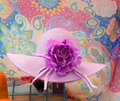 Purple hat with flower a summer large on it Royalty Free Stock Photography