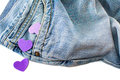 Purple hearts falling out of jeans pocket isolated Royalty Free Stock Photography