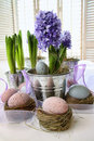 Purple hyacinths and easter eggs on table Stock Photos