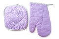 Purple kitchen glove and potholder isolated on a white Royalty Free Stock Photo