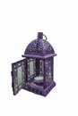 Purple lantern. Candlestick in the form of retro lamp. Purple candle holder/ lamp. An isolated object on white background. Royalty Free Stock Photo
