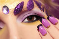 Purple makeup and nails with gold sequins decoration in the form of leaves Royalty Free Stock Images
