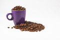 Purple mug with coffee beans 01 Royalty Free Stock Photo