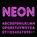 Purple Neon Light Alphabet Font. Royalty Free Stock Photo