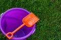 Purple Pail With Orange Shovel Stock Photos
