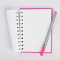 Purple Pen on Face purple notebook for background and text Royalty Free Stock Photo