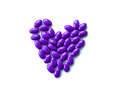 Purple pills on white background isolated Royalty Free Stock Photo