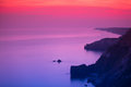 Purple and pink sunset over ocean Royalty Free Stock Photo