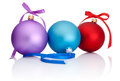 Purple, red and blue Christmas Ball with ribbon bow Royalty Free Stock Photo