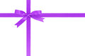 Purple ribbon cross with bow for packaging with tails isolated on white background Stock Images