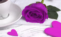 Purple rose and heart shape on white wood background, valentine`s day concept, love symbol.