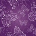 Purple seamless abstract ornament with white hand drawing butterflies vector illustration Stock Photos