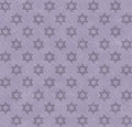Purple star of david patterned textured fabric background that is seamless and repeats Royalty Free Stock Images