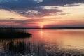 Purple sunset alarming near the water in belarus Stock Image