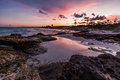 Purple sunset over a tropical rocky beach riviera maya yucatan mexico Stock Images