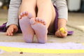Purple toes sidewalk chalk and a little girls feet covered in chalk dust Royalty Free Stock Image