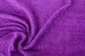 Purple towe towel as a background for your message Stock Images
