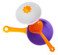 Purple toy pan with orange colander isolated on white background Royalty Free Stock Images