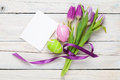 Purple tulip bouquet, easter eggs and blank greeting card Royalty Free Stock Photo