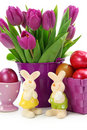 Purple tulips in bucket and two rabbits Royalty Free Stock Image