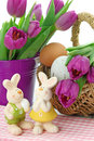 Purple tulips in bucket and two rabbits Stock Photos