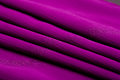 Purple, violet tender colored textile, elegance rippled material Stock Photos