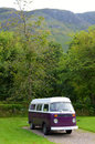 Purple and white camper van an old Stock Images