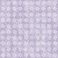 Purple and white decorative swirl design textured fabric backgro background that is seamless repeats Royalty Free Stock Photo