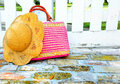 Purse and hat by gate Royalty Free Stock Photo