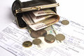Purse with money the lies on a kvatintion on a rent Royalty Free Stock Image