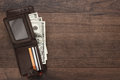 Purse with money on the wooden table Royalty Free Stock Photo