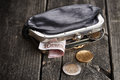 Purse with money on wooden table Royalty Free Stock Photo