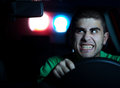 Pursuit police in of a man in the car selected focus on face Royalty Free Stock Images