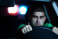 Pursuit police in of a man in the car selected focus on face Stock Images