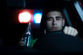 Pursuit police in of a man who is drinking in the car selected focus on face Stock Photo