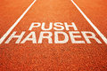 Push harder on athletics all weather running track Stock Images