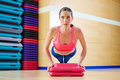Push up push ups woman exercise workout at gym indoor Royalty Free Stock Image