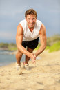 Push ups crossfit fitness man clapping push ups doing during training exercise workout on beach in summer fit male trainer and Stock Photo